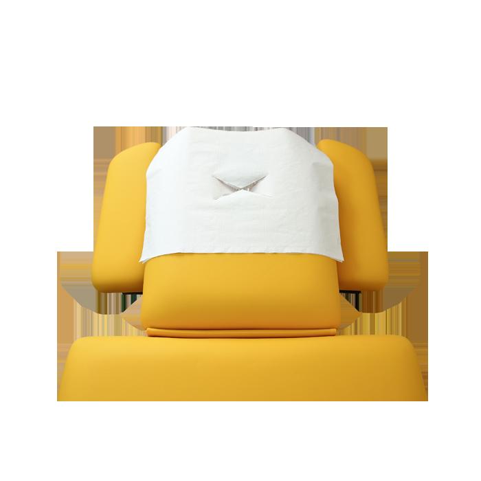 Nasenschlitztuch auf gelber Kopfstütze